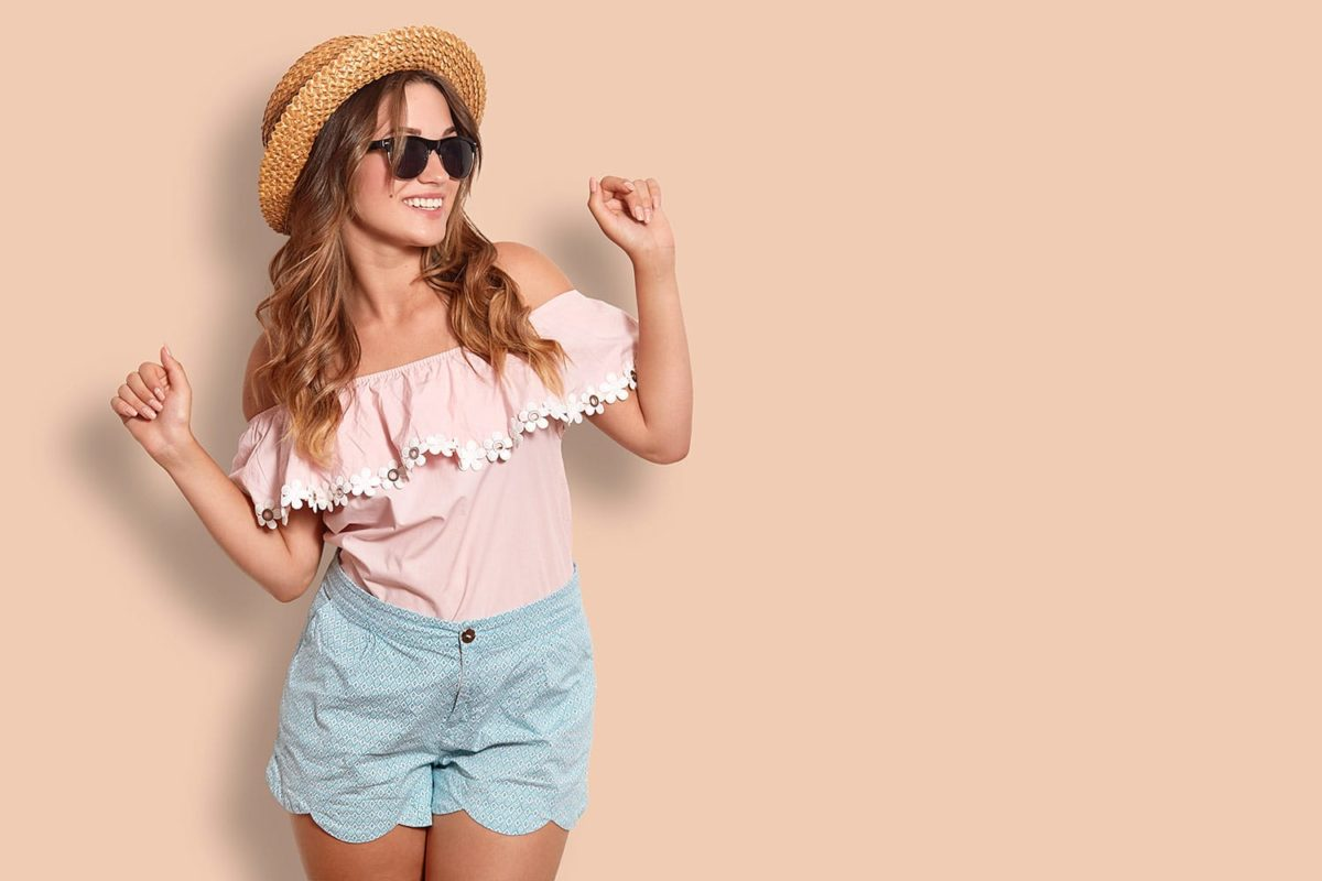 adorable female in summer clothing, has positive expression