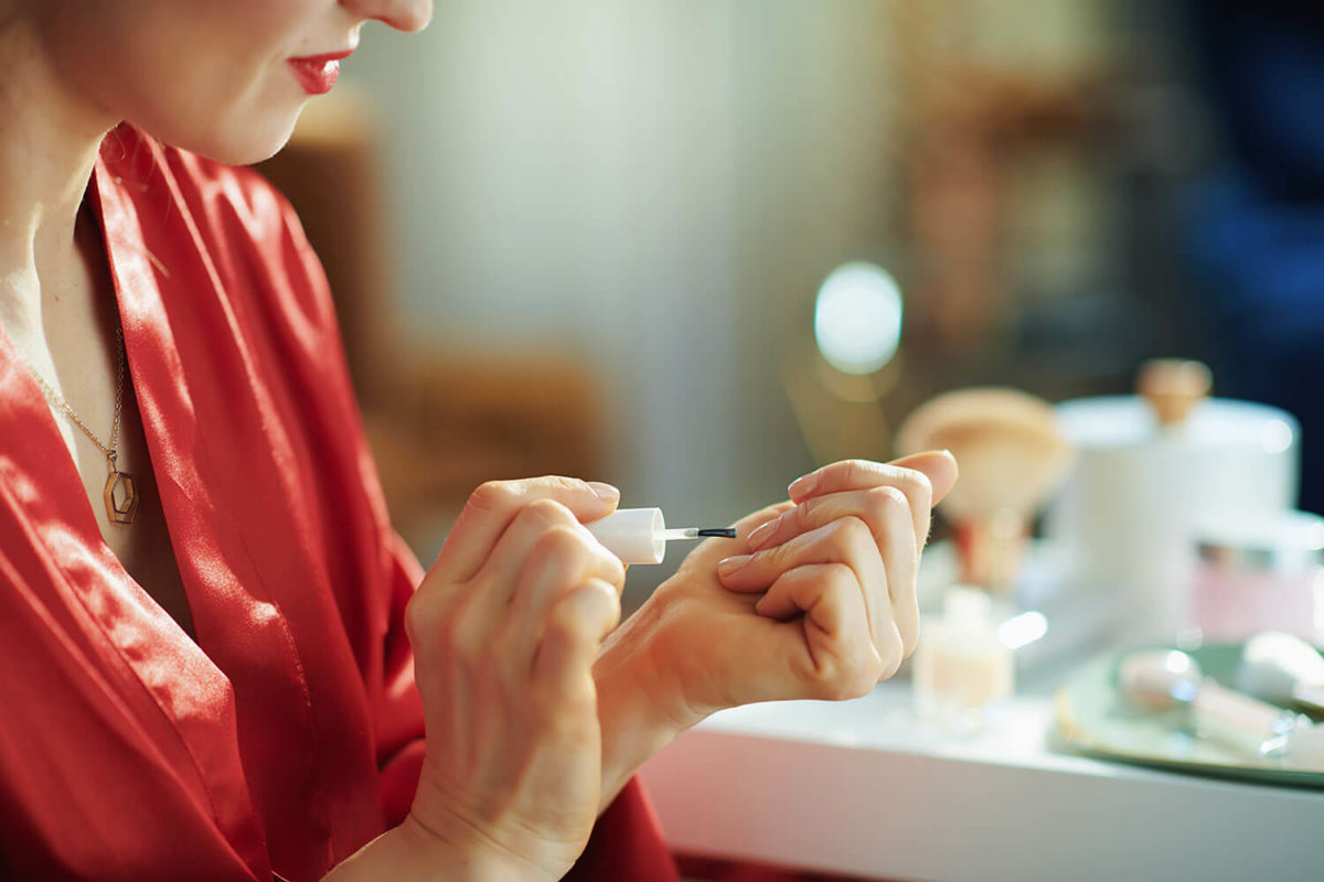 OPI Nail Polish. Woman applying nail polish.